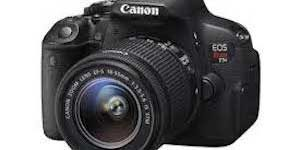 Canon EOS camera and lens.